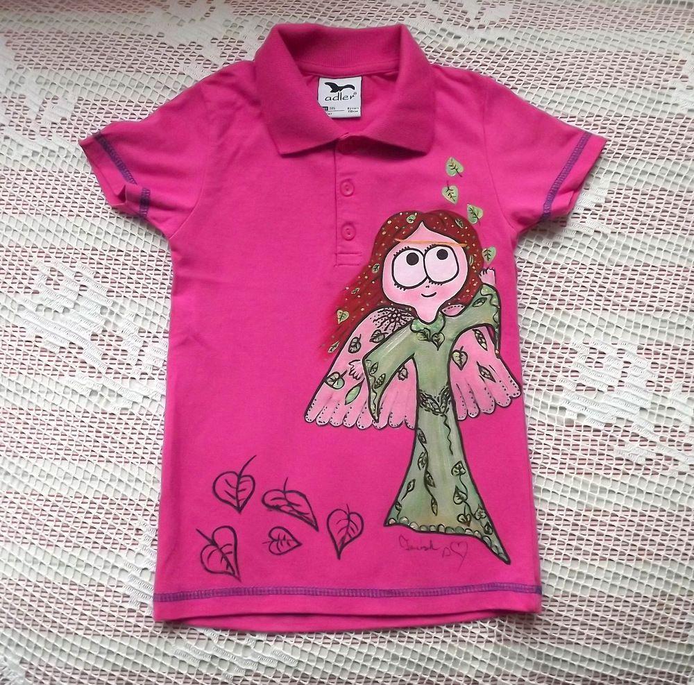 Růžové bavlněné tričko s krátkým rukávem, knoflíčky a límečkem. Na tričku je namalována roztančená víla velikost 110