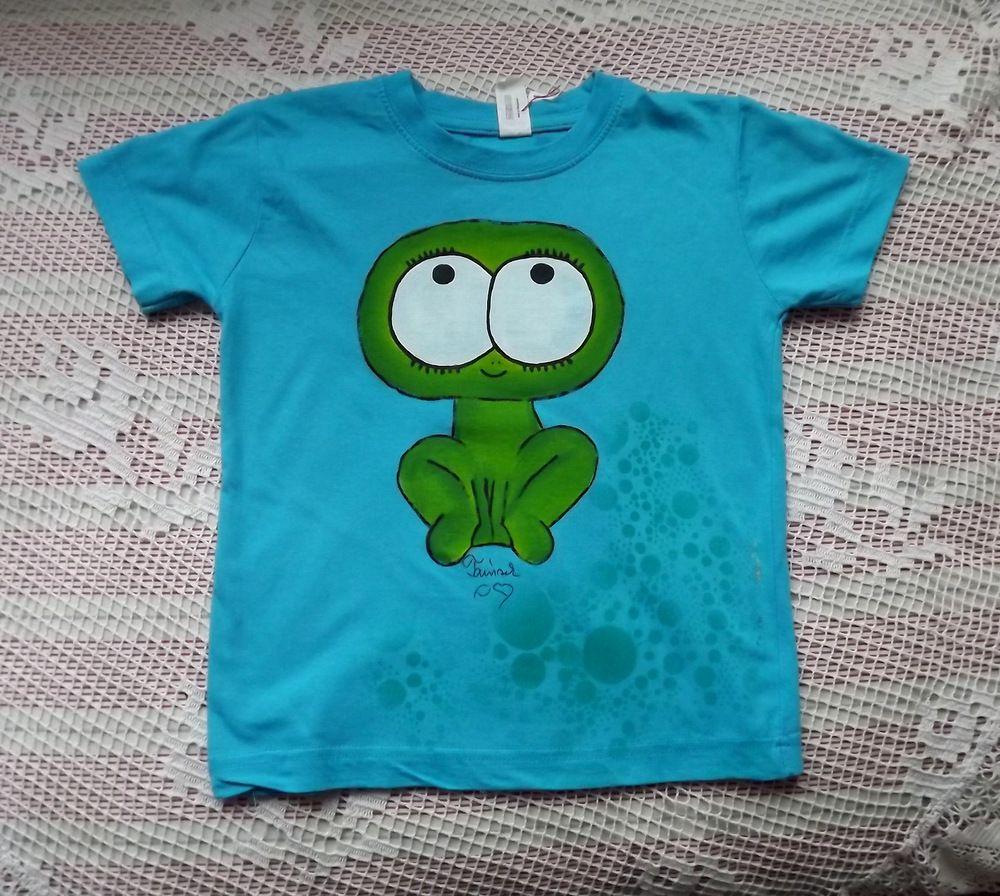 Veselá zelená okatá žba na tyrkysovém tričku,100% bavlna,krátké rukávy, velikost 116
