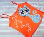 Tyrkysová střapatá kočička na oranžovém M