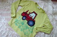 Červený traktor dr. 128